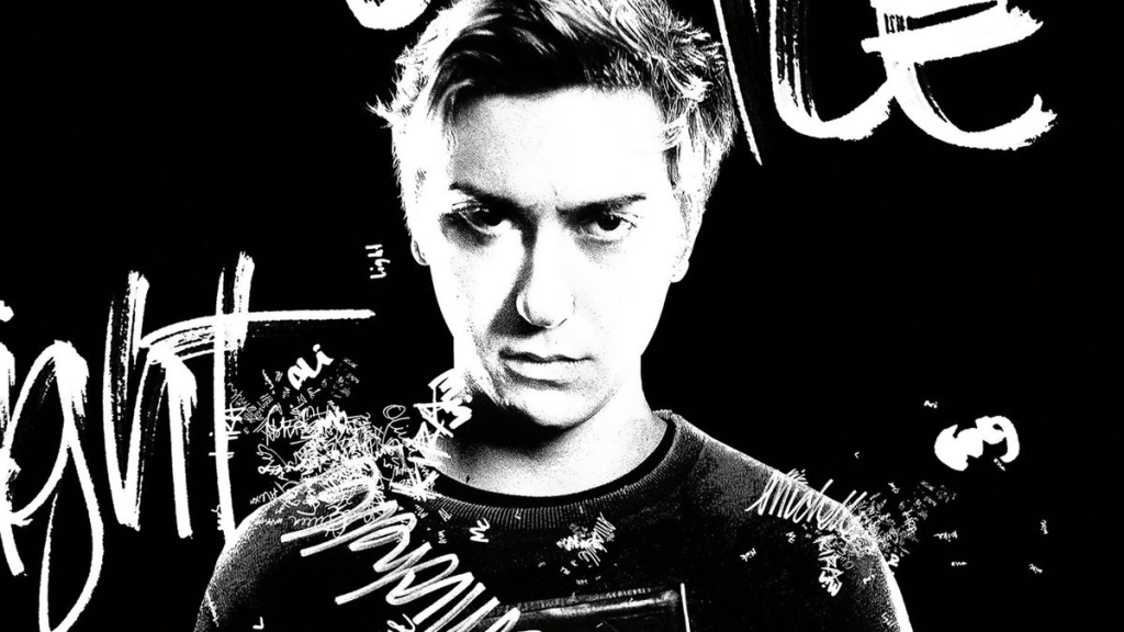A black and white promotional graphic for 'Death Note' (2017). Nat Wolff glares angrily at the screen like a tortured teen, the background is all black and graffiti is photoshopped over the image in white.