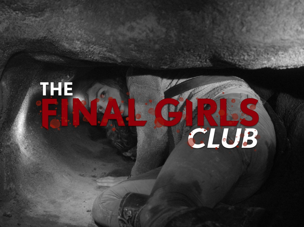A black and white still from 'As Above, So Below'. Scarlett (Perdita Weeks) is shown crawling through a tight caving system. she is turning her head back to face the camera. It is highly claustrophobic and she has only a headtorch to guide her. The Final Girls Club logo is edited over the top of the image.