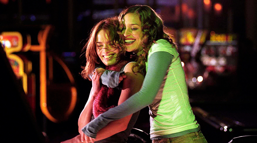 A still from 'Imagine Me & You'. Two women (played by Lena Headey and Piper Perabo) are embracing each other and laughing.