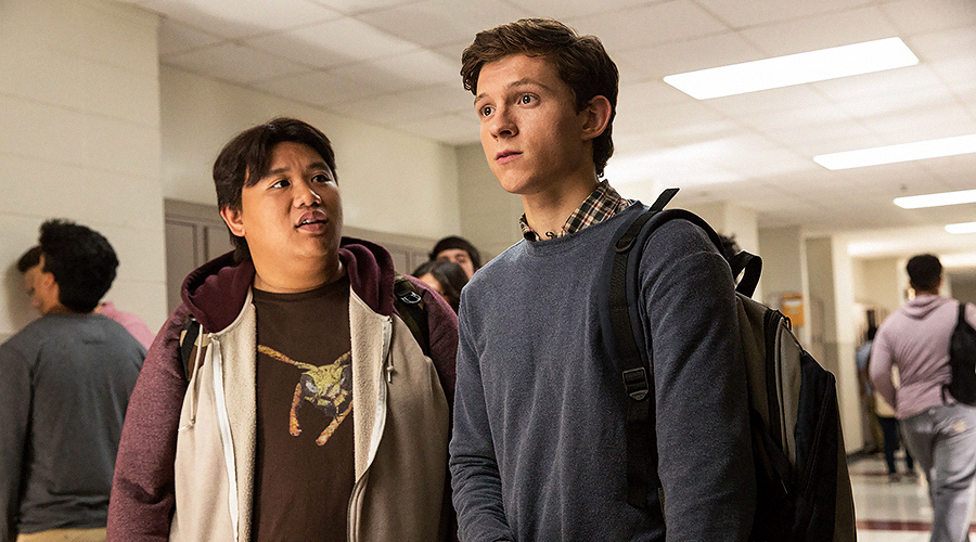 A still from 'Spider-Man: Homecoming'. Two teenage boys (played by Jacob Batalon and Tom Holland) are standing in the hallway of a high school.