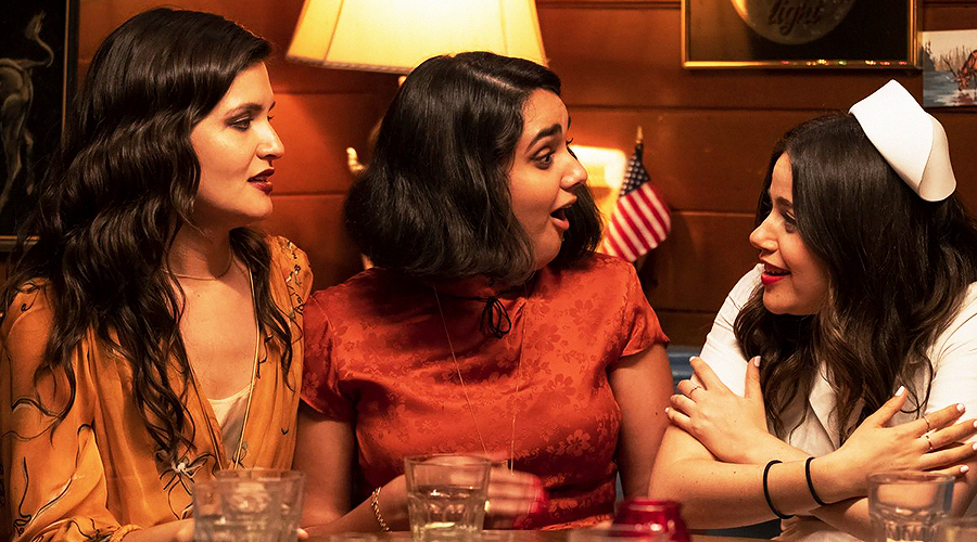 A still from 'The Broken Hearts Gallery'. Three young women (played by Phillipa Soo, Geraldine Viswanathan, and Molly Gordon) are sitting next to each other and looking surprised.