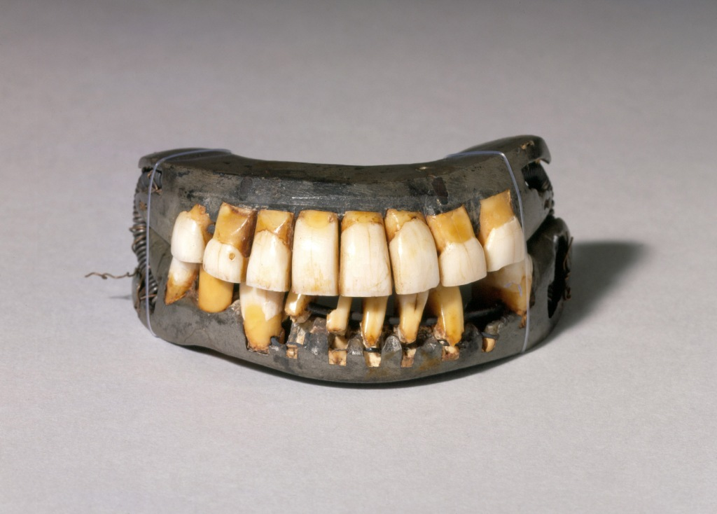 A set of old and yellowing teeth set in a cast metal mould, once belonging to George Washinton.
