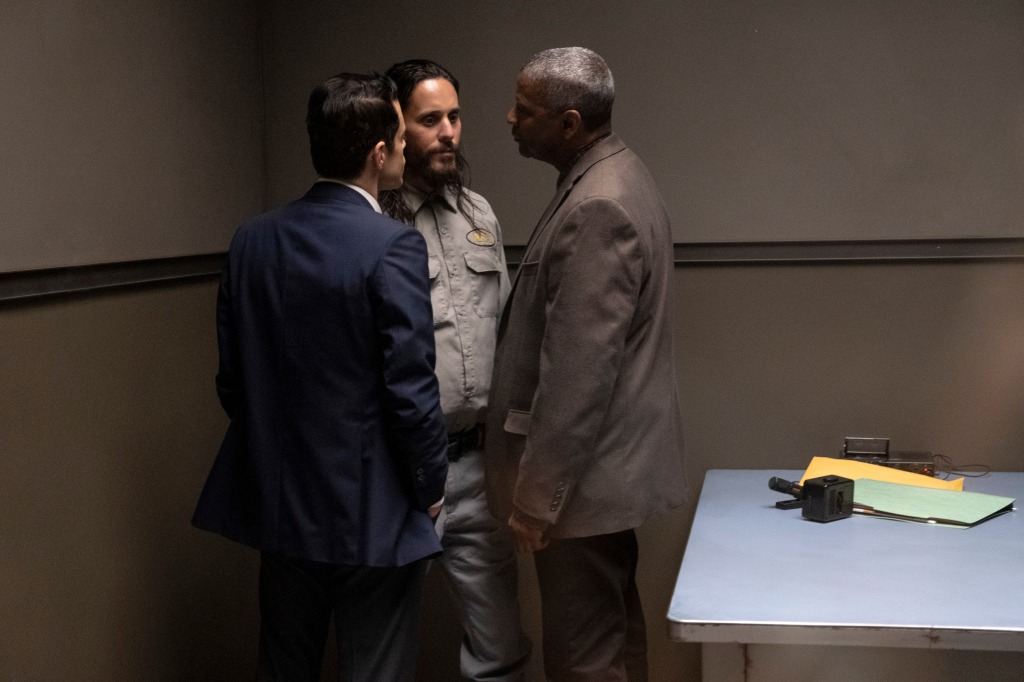 Rami Malek, Jared Leto and Denzel Washington as Jimmy, Sparma, Deke. Jimmy and Deke corner Sparma in a police interrogation room.