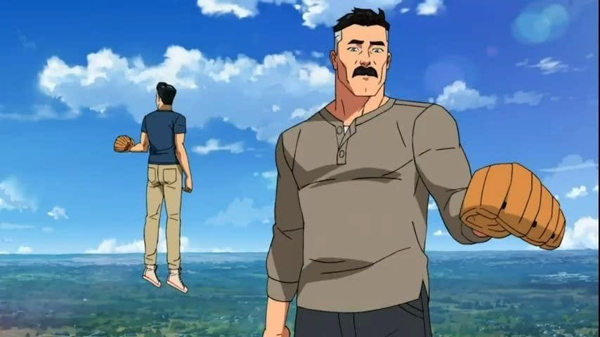 A still from cartoon TV show 'Invincible'. Mark Grayson (voiced by Steven Yuen) is shown in the background, floating in the sky with his back to the camera. His father (voiced by JK Simmons) stands in the foreground, to the right of the image. He is a muscular man with black hair that is graying, wearing a gray long sleeved top, and holding a baseball mitt.