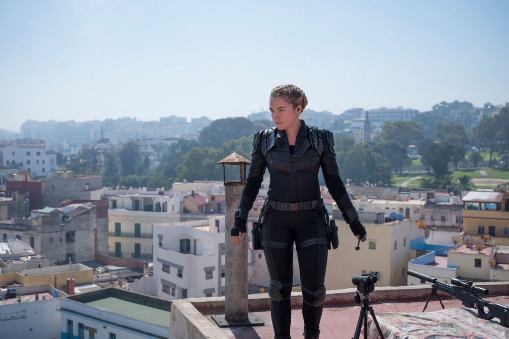 Yelena (Florence Pugh) standing on a roof in her Black Widow costume.