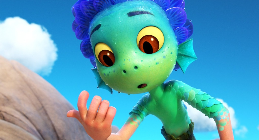 A still from animated film 'Luca'. A young sea monster is shown transforming into a human boy.