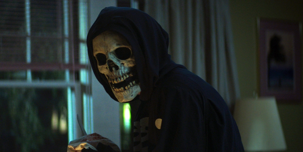 Fear Street's assailant in the skull mask and skeleton hoodie.