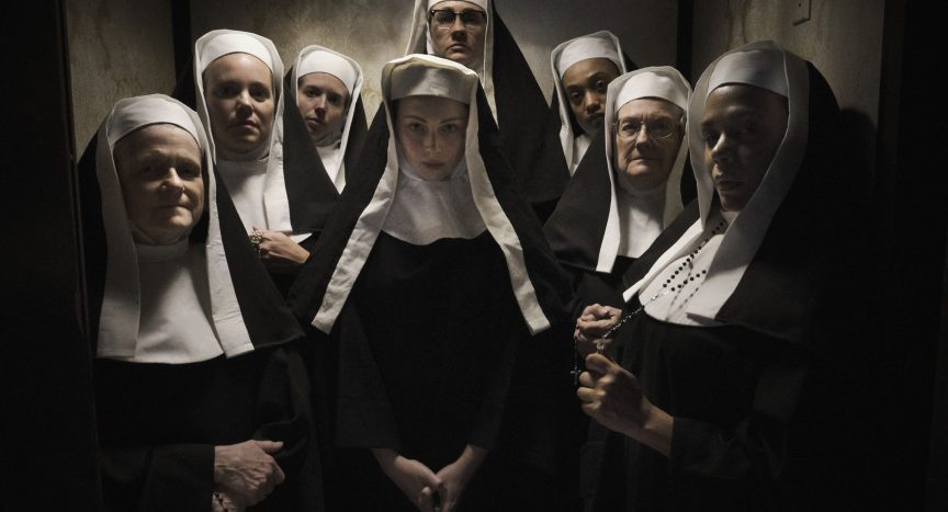 Still from 'Agnes'.  A group of nuns stand facing the camera, all in traditional high white and black habits.